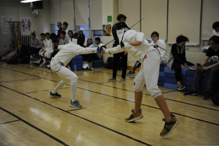 Students practice fencing on the Boys' Fencing team.