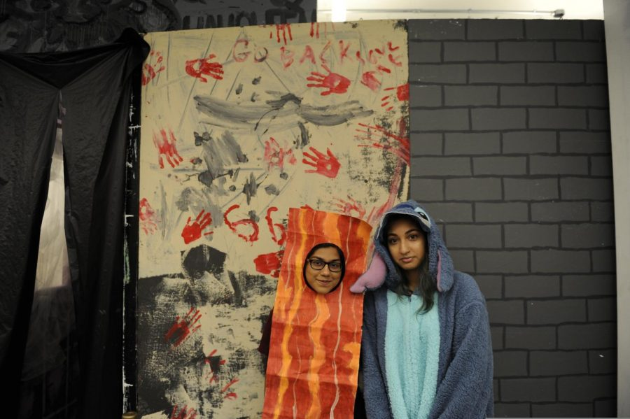 Members of the Student Organization dressed up in front of the Haunted House they created.
