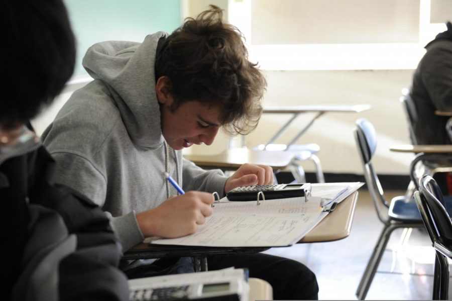A student works independently in AP Calculus AB- a popular course amongst both juniors and seniors.