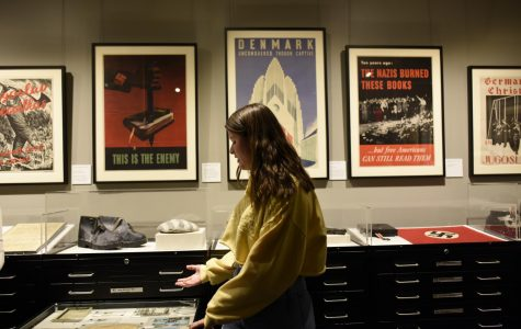 Student visitors are presented with a variety of artifacts in the Holocaust Museum.