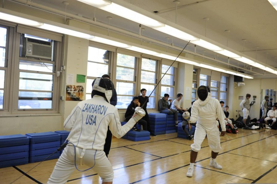 Students fence with each other.