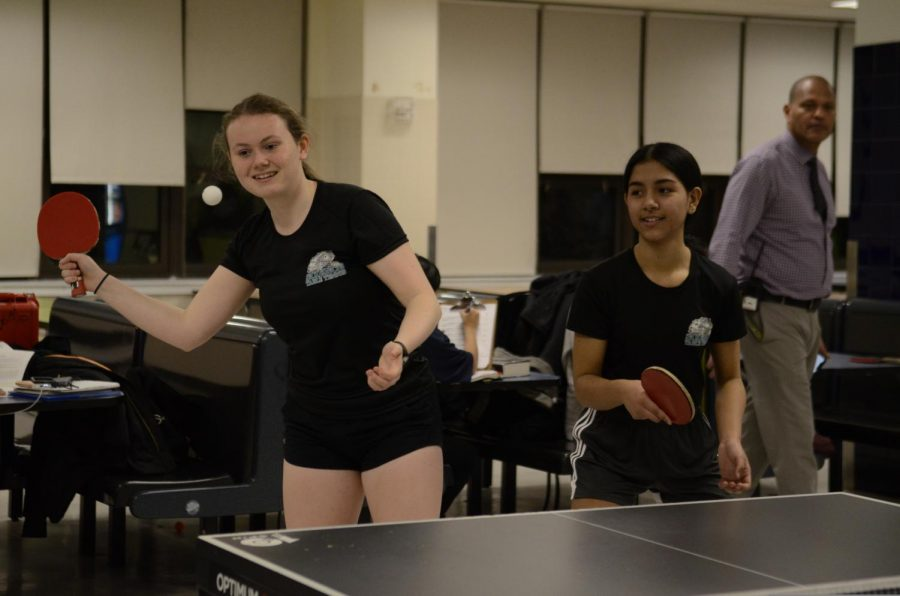 Lara Belton '21 and Chloe Guerrero '22 start a game of table tennis.