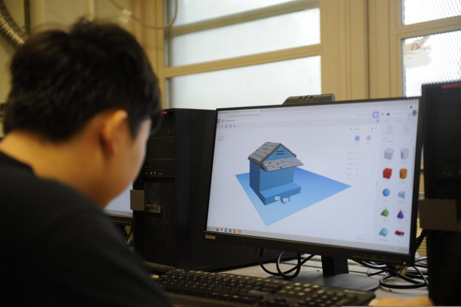 A ninth grader works on building a virtual house on Tinkercad.