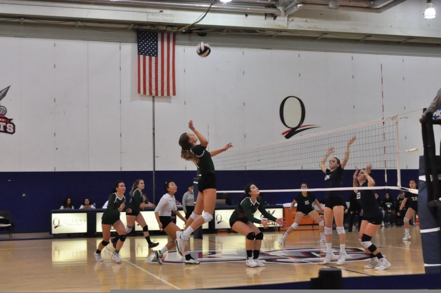 Anya Lollos '21 spiking the ball during a volleyball competition.