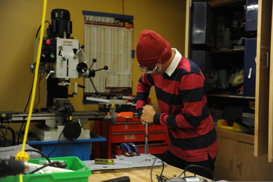 Sheikh Islam '23 stays after-school to help his robotics team!