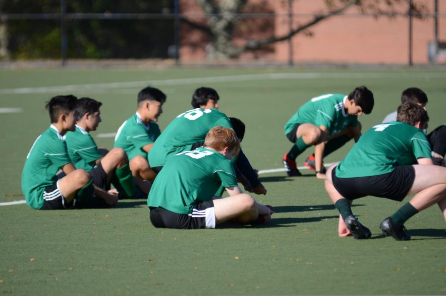 The Soccer Boys' Varsity team stretch before a game.