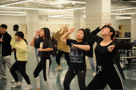 Music is a large part of most teenagers' lives, as with the Urban Dance Club. Here, they are hard at work synchronizing their dance moves during a rehearsal.