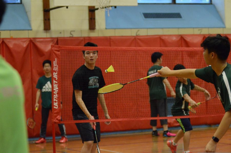 Raymon Huang '20 rallies with a friend before a game.
