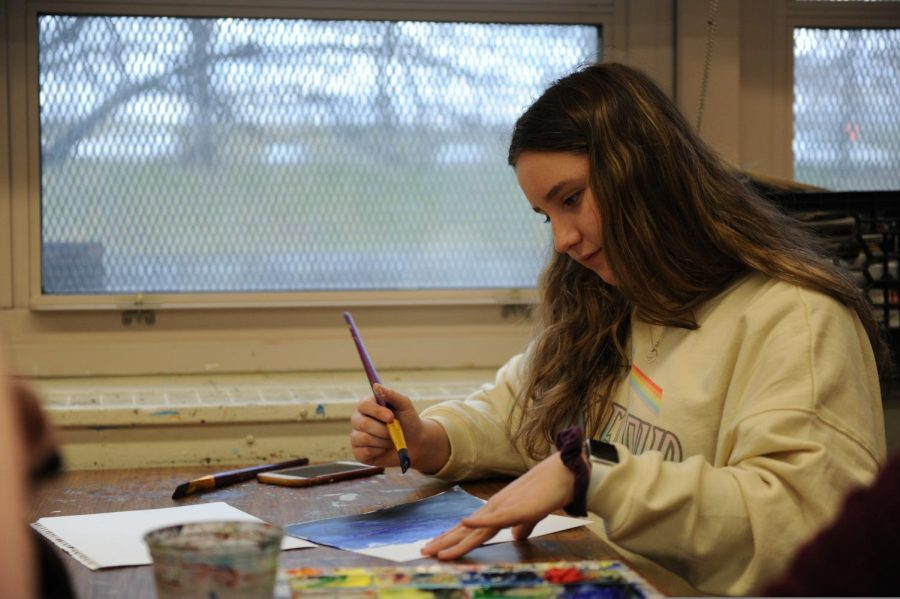 A student works on her painting.