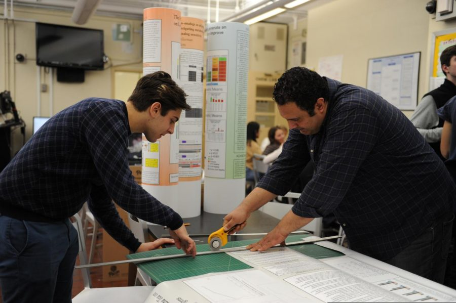 A senior in the Biology Research program works on the presentation of their data.