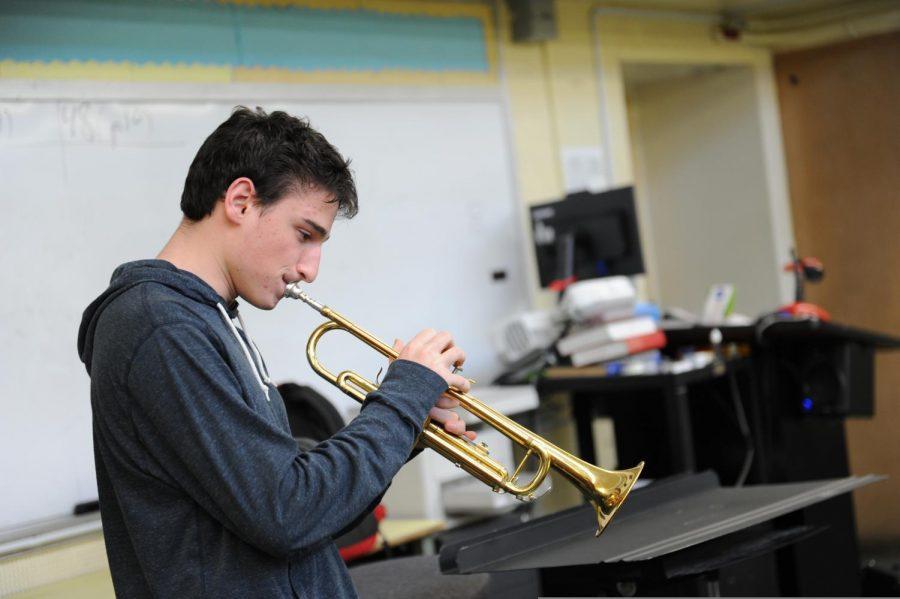 Ben Kofman '20 plays trumpet in a Jazz Club meeting.