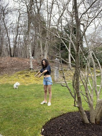 Isabel Bernstein '20 plays with her dog in their yard on Long Island.