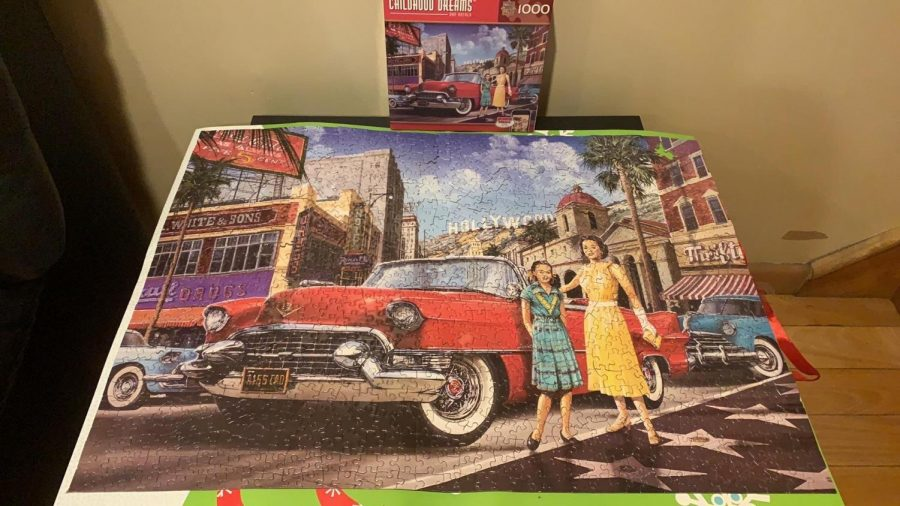"Here is the 1000-piece puzzle that Caitlyn Chen '20 completed at home with her mom. ""It took me five days and a lot of back pain, but we completed it,"" Chen said."