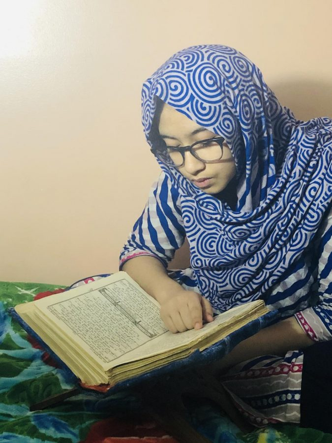 During Ramadan, people try to spend time doing acts of worship, such as reading the Quran.