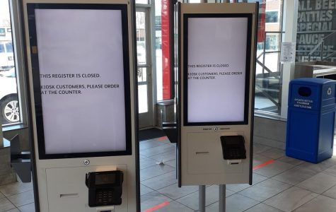 Normally bustling with activity, a McDonald's restaurant is forced to adhere to social distancing guidelines, shutting down its kiosks for the foreseeable future.