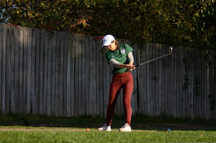 Girls golf at a competition.