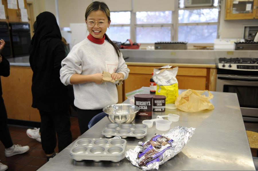 A student preparing to bake cookies in the baking club.
