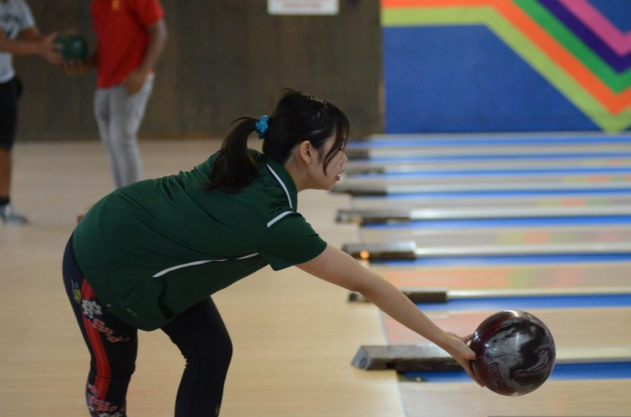 Girls bowling team bowling.