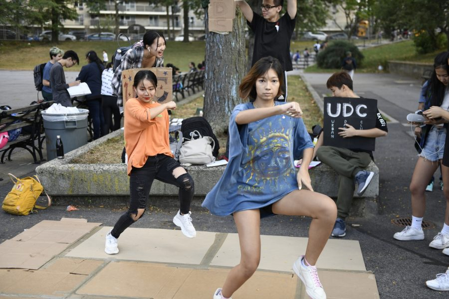 Here students are dancing at the club fair to promote their urban dance club.