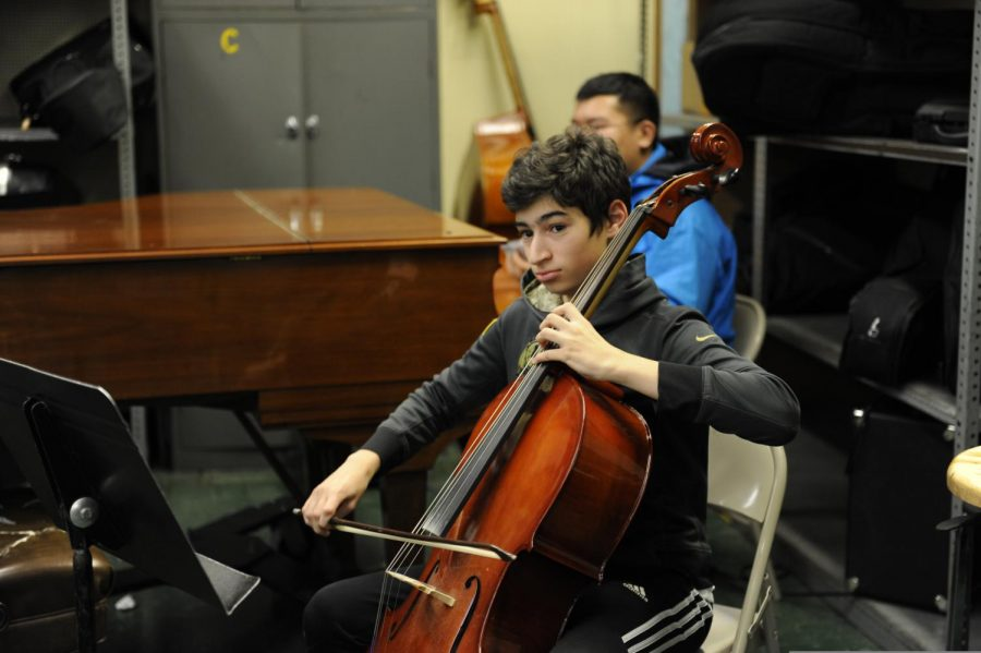 A student in the Chamber Music Club playing the cello.