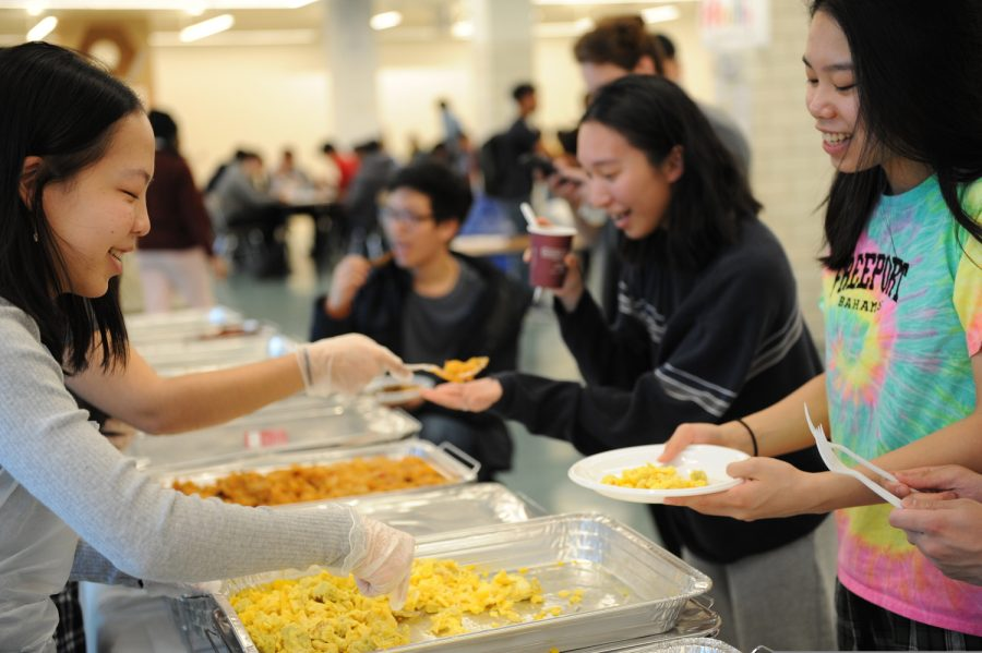 Pamela Li '20 helps out during Senior Brunch, which was one of the last senior events held at school, where seniors came together to celebrate and destress.
