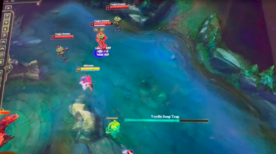 "Here we see a Yordle and a character hitting target dummies during some high quality, high definition 'League of Legends' gameplay. ""It's important to practice LoL; that way you can be better whenever you play with your friends, and you'll have more fun"" said Jonathan Pang '21."