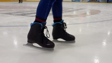 A close up of an ice skater
