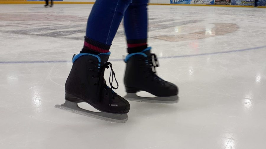 A+close+up+of+an+ice+skater%27s+skates.+