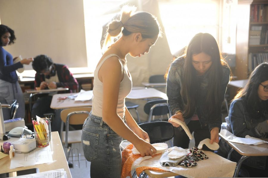 Students in the Craft for Humanity Club crafting outerwear.