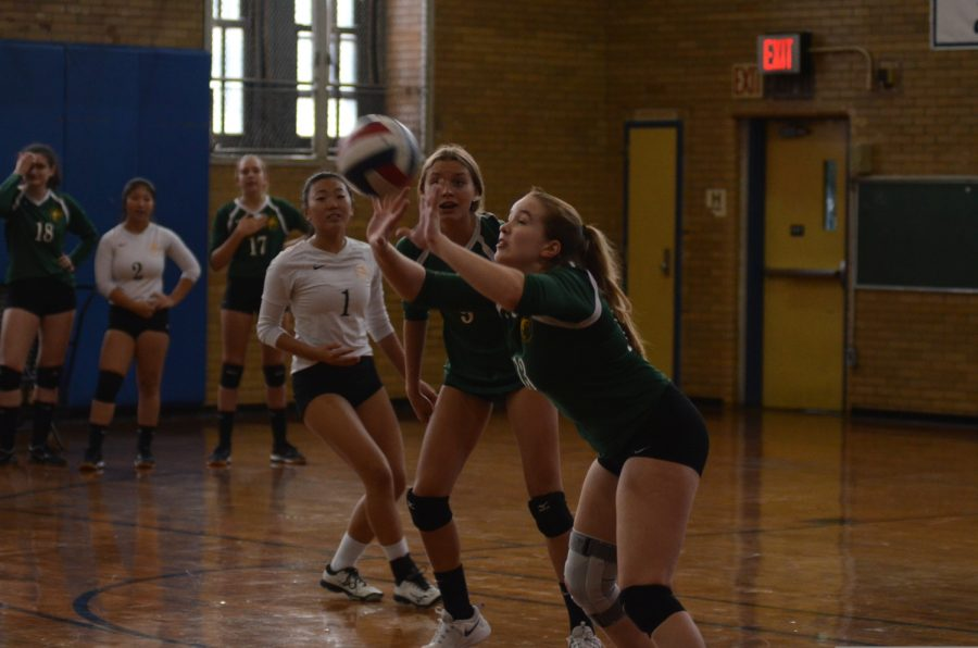 A player on the PSAL championship-winning girls varsity volleyball team sets up the ball during a tense game.