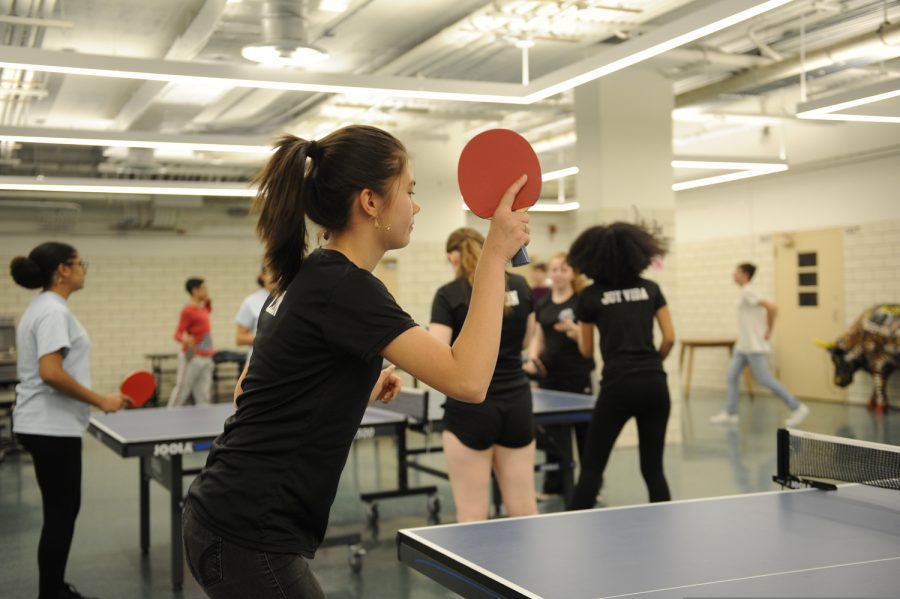 The varsity girls table tennis team rallies during their practice in the Bronx Science cafeteria.
