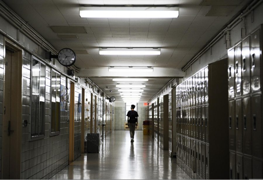 A poetic photograph depicts student life in a Bronx Science hallway.