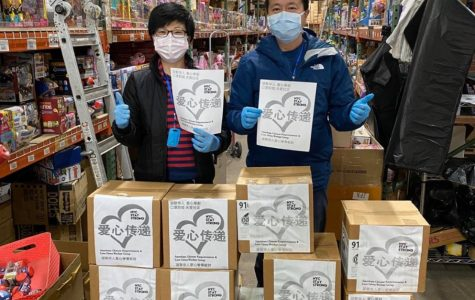 """Lin's parents stand inside of their toy warehouse. """"It hasn't been that hard balancing my volunteering efforts with school since my parents do most of the work. I usually go to the warehouse on weekends when I don't have school to help pack masks, since we also have been mailing them out to people,"""" said YuZhen Lin."""
