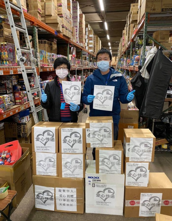 "Lin's parents stand inside of their toy warehouse. ""It hasn't been that hard balancing my volunteering efforts with school since my parents do most of the work. I usually go to the warehouse on weekends when I don't have school to help pack masks, since we also have been mailing them out to people,"" said YuZhen Lin."