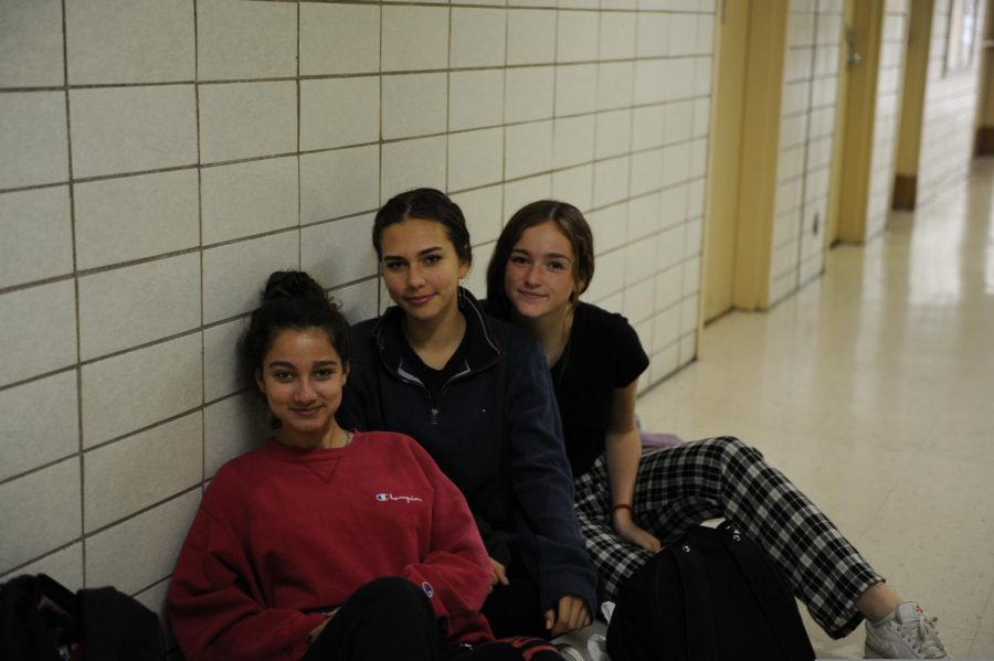 Students pose for a picture in the hallway.