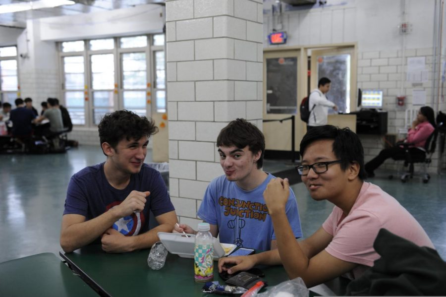 Students laugh with each other during lunch.