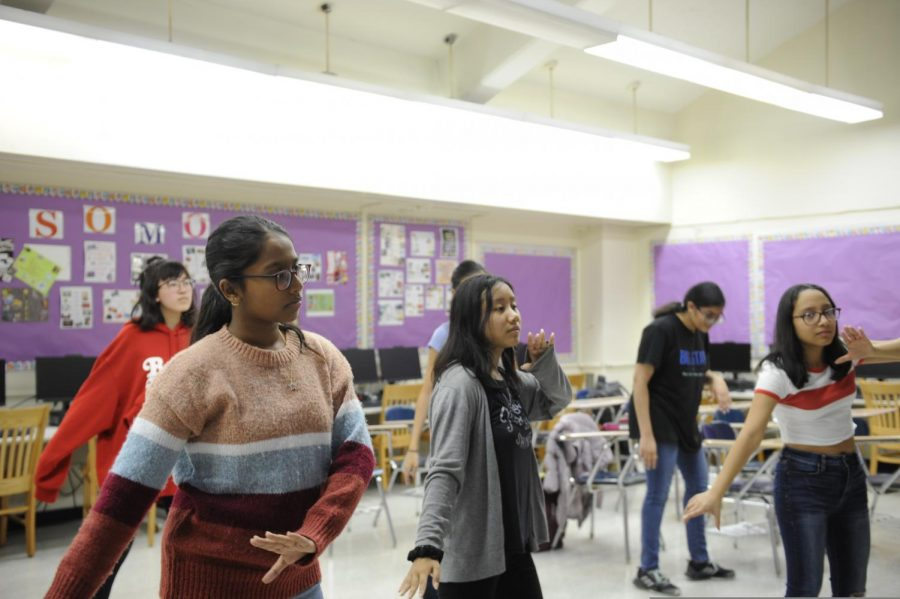 Students practice a dance in East Asian Entertainment Club.