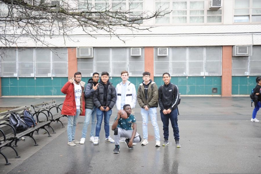 Students pose for a photo while spending their time with each other at the courtyard.