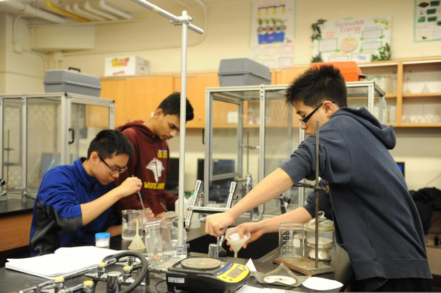 These students use a variety of materials to complete a lab.