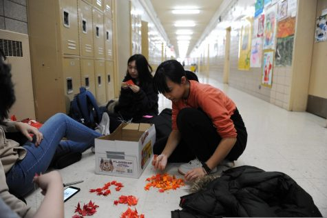 Students make origami during their free period.