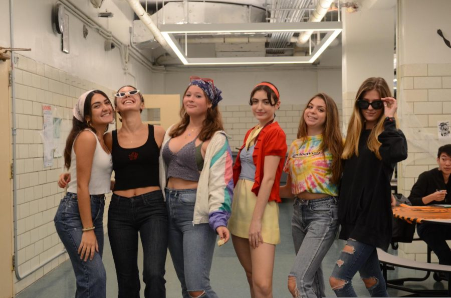 A group of seniors celebrate Halloween by dressing up in festive costumes and having fun with friends!