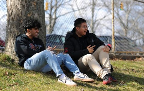 Sabin Alam '20 and Hanil Chung '20 laugh together in the Bronx Science courtyard, sharing a moment of levity during their lunch period.