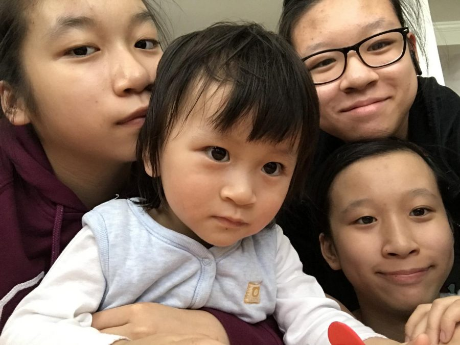 Yvonne+Fong+%2723%2C+her+twin+sisters%2C+and+her+youngest+sister+all+spend+quality+time+together+during+quarantine%2C+a+silver+lining+during+the+Coronavirus+pandemic.+%0A