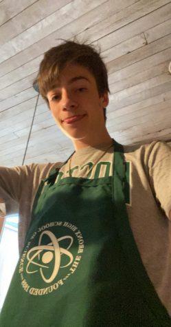 Kieran Aug '20 wears a Bronx Science apron.