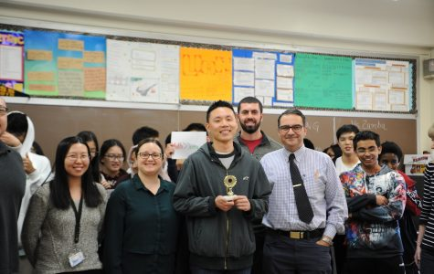 This photograph, taken  earlier in the academic year, shows Mr. Liang winning the rap battle that he had with physics teacher Mr. Blake. Ms. Li and Ms. Costanzo are there as well. In the karaoke sessions, Mr. Liang does rap, which is another reason why these karaokes are so great. The Mathematics teachers are happy to show off their musical talent, whether it is through their singing, guitar playing, or by rapping.