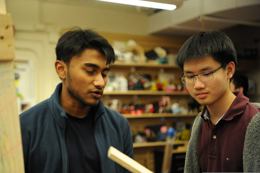 Fayyad Zakaria '20, pictured on the left, works with a fellow member during Makerspace.