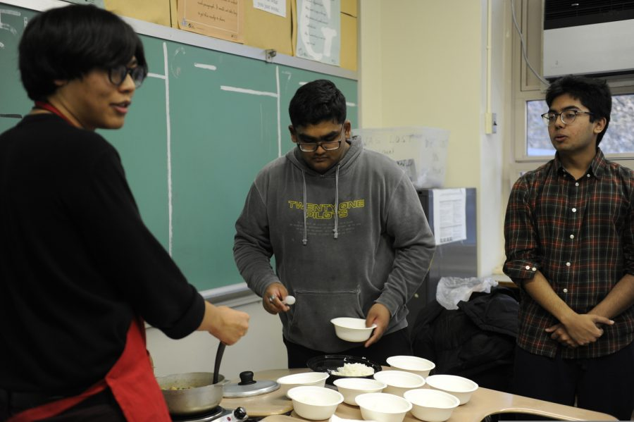 Students share a traditional Filipino dish.