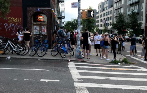 A local bar in Williamsburg, Brooklyn, during the Coronavirus pandemic, shows that many people are not following social distancing precautions or wearing masks.