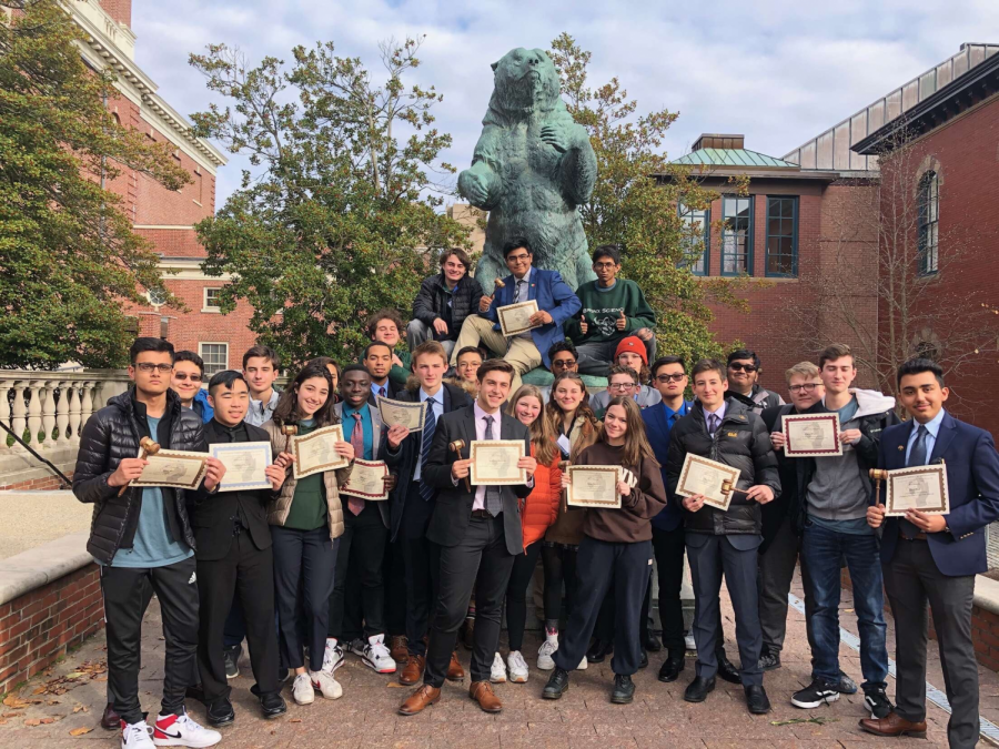The 2019-2020 SciMUN team gathers after their successful results at the Brown University Model UN conference, in a pre-COVID world when in-person tournaments could occur.