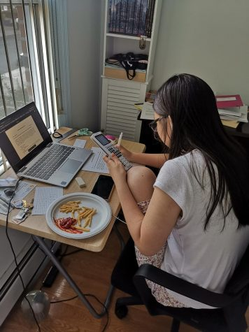 Kelly Hu '22, a student at Stuyvesant High School, routinely sits at her desk for up to twelve hours a day. She often brings and eat her daily meals at her desk, while she is working and attending remote Zoom classes.